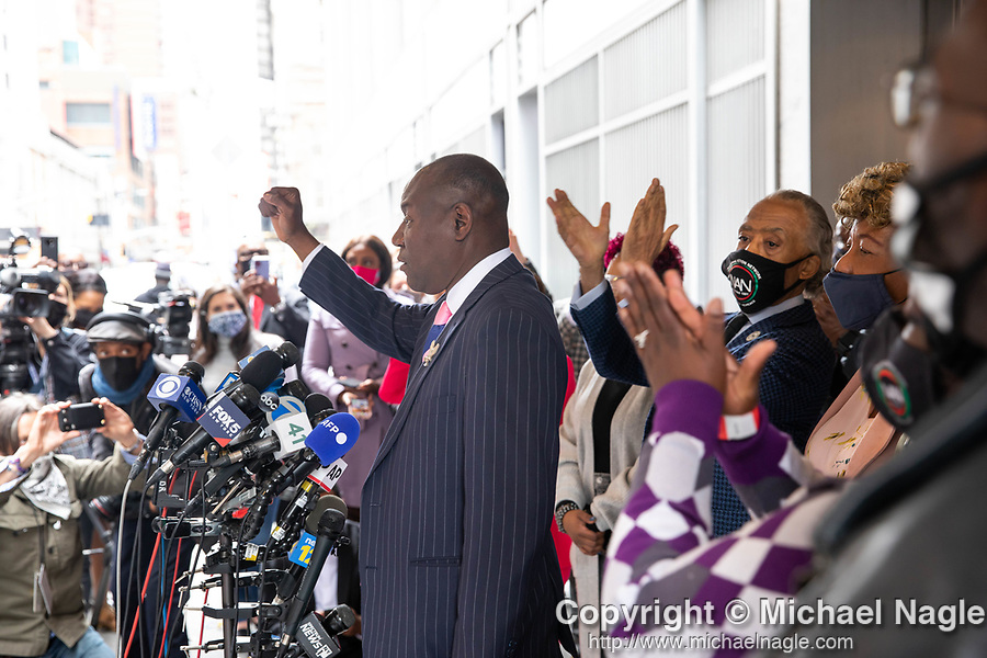 """Benjamin Crump, attorney for the family of Duante Wright, center, speaks at a press conference in response to the George Floyd and Duante Wright cases along with Reverend Al Sharpton, second from right, and members of the """"Mother's of the Movement"""" during the National Action Network (NAN) Virtual Convention 2021 in New York on Wednesday, April 14, 2021. Photograph by Michael Nagle"""