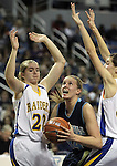 Foothill's Bri Higgins attempts a shot past Reed defenders during a semi-final game in the NIAA 4A State Basketball Championships between Reed and Foothill high schools at Lawlor Events Center in Reno, Nev, on Thursday, Feb. 23, 2012. .Photo by Cathleen Allison