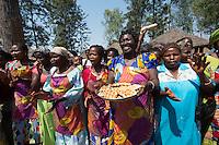 Africa, DRC, Democratic Republic of the Congo, South Kivu, Kamanyola. Women for Women project. WFW Kamanyola co-op and lifeskills training. Women dancing in greeting and their Belgium waffles.