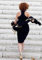 L'attrice Lucrezia Lante della Rovere corre sulle scale della Basilica di Santa Maria in Aracoeli per la cerimonia nuziale di Valeria Marini e Giovanni Cottone, a Roma, 5 maggio 2013..UPDATE IMAGES PRESS/Riccardo De Luca