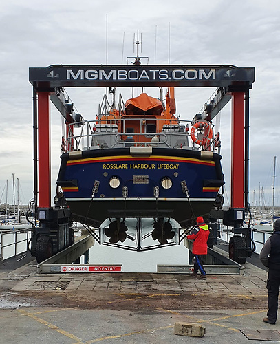 Rosslare RNLI Lifeboat in the boat hoist slings at the MGM Boatyard in Dun Laoghaire Harbour