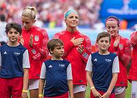 PARIS,  - JUNE 28: Julie Ertz #8 stands for the national anthem during a game between France and USWNT at Parc des Princes on June 28, 2019 in Paris, France.