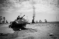 Gaddafi army tanks burn in Bir Ayad, Libya.