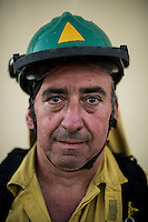 Jose Antonio Sánchez Baeza (Martillo)  of Carratraca, Málaga. The firefighter from the BRICA Málaga 703, the Andalusian Service firefighting (INFOCA),  posses after a wildfire in Los Barrios near Cadiz on July 25, 2015. © Pedro ARMESTRE