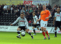 ATTENTION SPORTS PICTURE DESK<br /> Pictured: Leon Britton of Swansea (L) marked by Keith Southern of Blackpool (R)<br /> Re: Coca Cola Championship, Swansea City Football Club v Blackpool at the Liberty Stadium, Swansea, south Wales. Saturday 24 October 2009