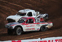 Mar. 20, 2011; Chandler, AZ, USA;  LOORRS pro lite driver Rodrigo Ampudia (36) races alongside Corey Sisler during round two at Firebird International Raceway. Mandatory Credit: Mark J. Rebilas-