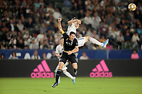 CARSON, CA - SEPTEMBER 15: Zlatan Ibrahimovic #9 of the Los Angeles Galaxy and Matt Besler #5 of Sporting Kansas City battle during a game between Sporting Kansas City and Los Angeles Galaxy at Dignity Health Sports Complex on September 15, 2019 in Carson, California.