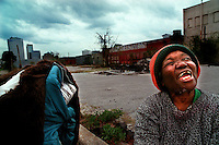 As a storm brew overhead, homeless woman Gertrude Quarles waits for dinner to be served behind the Salvation Army in Jacksonville Sunday afternoon.