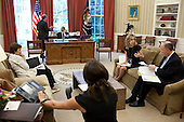 United States President Barack Obama talks with Mike Froman, Deputy National Security Advisor for International Economic Affairs, before a call in the Oval Office, August 10, 2011. Pictured, from left, are; Caroline Atkinson, Special Assistant to the President for International Economic Affairs; NSC Deputy Executive Secretary Valerie Boyd; Liz Sherwood-Randall, Special Assistant to the President and NSC Senior Director for European Affairs; and National Security Advisor Tom Donilon. .Mandatory Credit: Pete Souza - White House via CNP