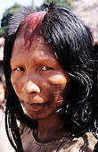 Bacaja village, Amazon, Brazil. Mother with shaved head and cut, bleeding scalp, to show her own pain; Xicrin tribe initiation.