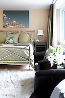 Black leather armchairs in the bedroom
