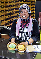 Young Malaysian Waitress Presenting Ice Cream Puff Desserts, Ipoh, Malaysia.