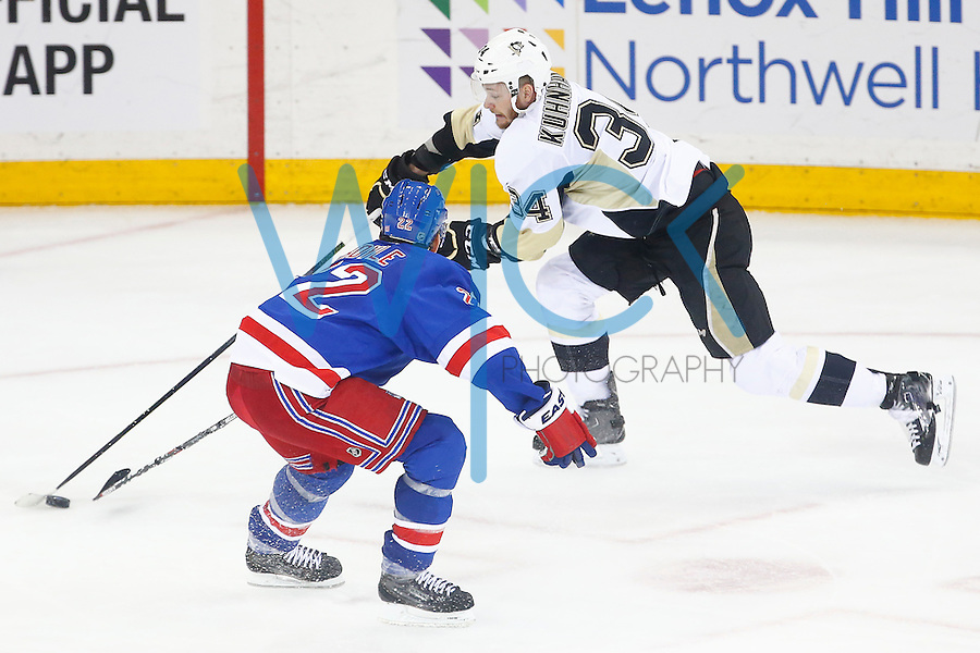 Tom Kuhnhackl #34 of the Pittsburgh Penguins carries the puck up the ice in front of Dan Boyle #22 of the New York Rangers in the third period during game three of the first round of the Stanley Cup Playoffs at Madison Square Garden in New York City on April 19, 2016. (Photo by Jared Wickerham / DKPS)