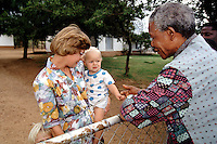 Nelson Mandela greets a white family that owns a large farm, while campaigning for President.   After more then 27 years in jail as an anti-apartheid activist,   Nelson Mandela lead a 1994 campaign for President as a member of the African National Congress (ANC),  in the first free elections in South Africa in 1994.  Mandela has received more than 250 awards over four decades, including the 1993 Nobel Peace Prize..