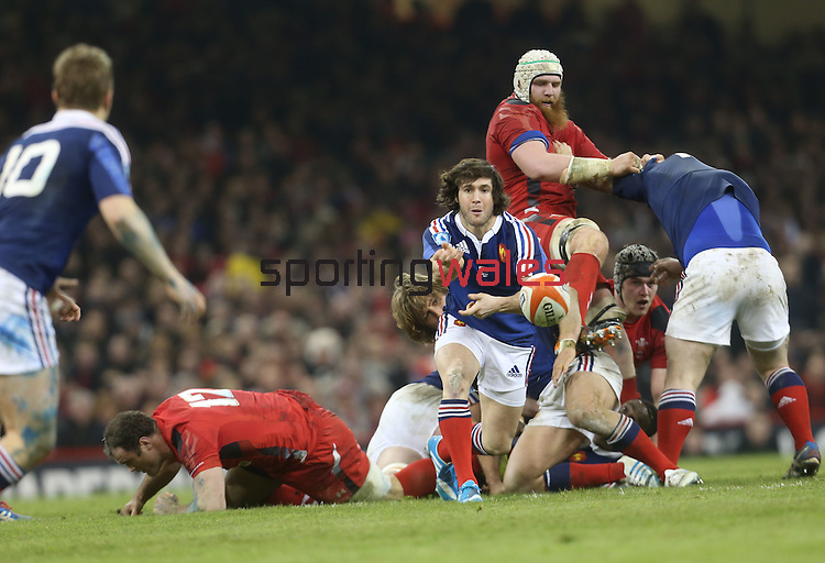 France replacement scrum half Maxime Machenaud whips the ball out to Jules Plisson.<br /> RBS 6 Nations 2014<br /> Wales v France<br /> Millennium Stadium<br /> 21.02.14<br /> <br /> ©Steve Pope-SPORTINGWALES
