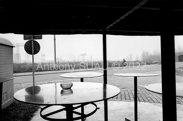 Buna, Germany  .1998.On the outskirts of a chemical factory a small cafe is set up where once chemical dust from the factory filled the streets. Residents in the town say that as much as 70% of the factory is now closed down. The pollution of ten-years ago is gone as well....