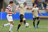 Houston, TX - Friday December 11, 2016: Ian Harkes (16) of the Wake Forest Demon Deacons clears the ball from Foster Langsdorf (2) of the Wake Forest Demon Deacons at the NCAA Men's Soccer Finals at BBVA Compass Stadium in Houston Texas.