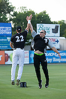 Kannapolis Intimidators conditioning coach Bret Kelly high fives Michael Suiter (22) prior to the game against the Lakewood BlueClaws at Kannapolis Intimidators Stadium on May 10, 2016 in Kannapolis, North Carolina.  The BlueClaws defeated the Intimidators 5-3.  (Brian Westerholt/Four Seam Images)