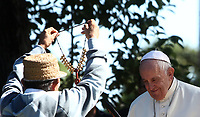 Pope Francis receives a gift from a member of an indigenous community of the Amazon during celebrations for the feast of St. Francis of Assisi, in the Vatican Garden at the Vatican, on October 4, 2019.<br /> UPDATE IMAGES PRESS/Isabella Bonotto<br /> <br /> STRICTLY ONLY FOR EDITORIAL USE