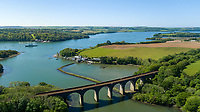 BNPS.co.uk (01202 558833)<br /> Pic: Savills/BNPS<br /> <br /> Pictured: The property and the Forder Railway Viaduct.<br /> <br /> A former tidal mill next to an impressive viaduct that looks like the perfect backdrop for a children's book is on the market for £3.5m.<br /> <br /> The Old Mill is over 600 years old and would be an ideal home for Swallows and Amazons or The Railway Children-inspired adventures.<br /> <br /> The impressive Grade II listed six-bedroom house has its own private harbour and panoramic views of the much-photographed Forder Railway Viaduct.<br /> <br /> It is only the second time the property in Cornwall has been on the market since 1886 and agents Savills say it is a once in a lifetime opportunity.