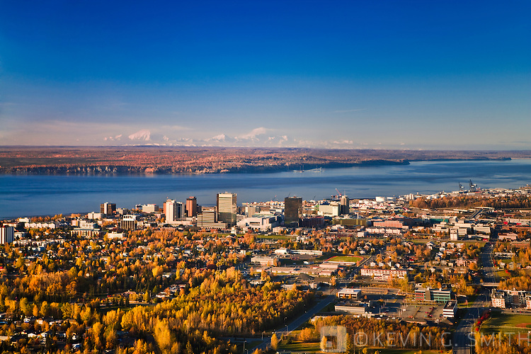 Aerial view of Anchorage, looking to the north with the Alaska Range behind it, fall foliage, sunset, Anchorage, Alaska, USA.