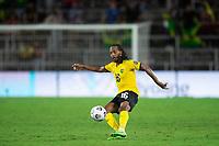 ORLANDO, FL - JULY 20: Daniel Johnson #16 of Jamaica kicks the ball during a game between Costa Rica and Jamaica at Exploria Stadium on July 20, 2021 in Orlando, Florida.