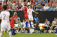 CHARLOTTE, NC - OCTOBER 03: Becky Sauerbrunn #4 of the United States and JI Soyun #10 of Korea Republic battle in the air for a ball during a game between USA and Korea Republic at Bank of American Stadium, on October 03, 2019 in Charlotte, NC.