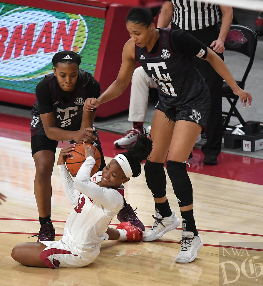 Arkansas' Makayla Daniels struggles for the ball with Texas A&M's Aaliyah Wilson (left) and N'dea Jones Sunday Jan. 10, 2021 at Bud Walton Arena in Fayetteville. Arkansas lost 74-73. Visit nwaonline.com/210111Daily/ and nwadg.com/photos. (NWA Democrat-Gazette/J.T. Wampler)