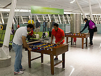 Football fans play table football in Brasilia Airport