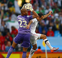 Rais M'Bolhi (23) of Algeria saves under pressure from Landon Donovan (right) of USA USA defeated Algeria 1-0 in stoppage time in the 2010 FIFA World Cup at Loftus Versfeld Stadium in Pretoria, Sourth Africa, on June 23th, 2010.