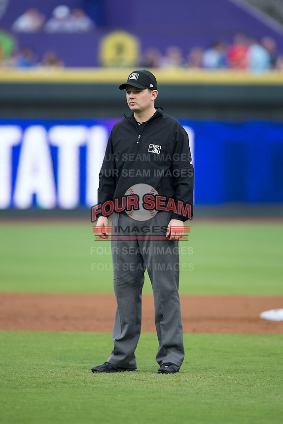 Umpire Mike Provine handles the calls on the bases during the Carolina League game between the Carolina Mudcats and the Winston-Salem Dash at BB&T Ballpark on July 23, 2015 in Winston-Salem, North Carolina.  The Dash defeated the Mudcats 3-2.  (Brian Westerholt/Four Seam Images)