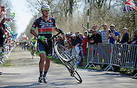 Yauheni Hutarovich (BLR/Bretagne - Séché Environnement) comes running out of <br /> sector 18: Trouée d'Arenberg - Wallers Forest with a completely smashed front wheel<br /> <br /> 113th Paris-Roubaix 2015