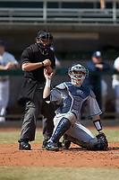 Nate Soria (5) of the Xavier Musketeers gets a ball from home plate umpire Reid Churchill during the game against the Penn State Nittany Lions at Coleman Field at the USA Baseball National Training Center on February 25, 2017 in Cary, North Carolina. The Musketeers defeated the Nittany Lions 10-4 in game one of a double header. (Brian Westerholt/Four Seam Images)