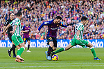 Lionel Andres Messi of FC Barcelona (C)  competes for the ball with Marc Bartra Aregall of Real Betis (R) during the La Liga 2018-19 match between FC Barcelona and Real Betis at Camp Nou, on November 11 2018 in Barcelona, Spain. Photo by Vicens Gimenez / Power Sport Images