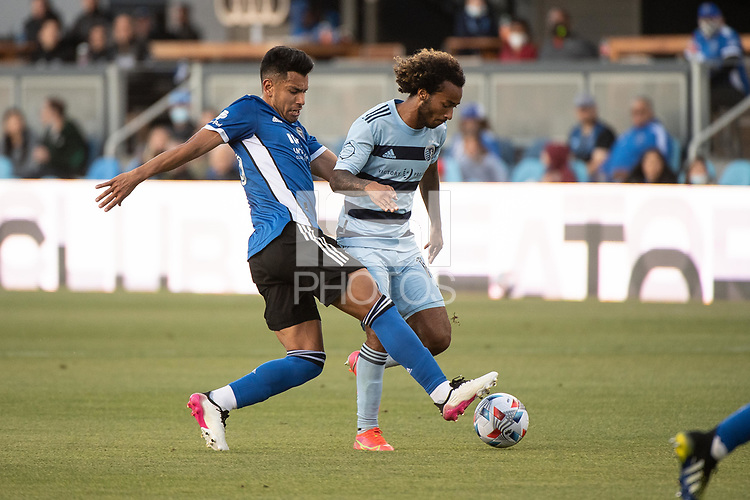 SAN JOSE, CA - MAY 22: Andres Rios #25 of the San Jose Earthquakes challenges Gianluca Busio #10 of Sporting Kansas City during a game between San Jose Earthquakes and Sporting Kansas City at PayPal Park on May 22, 2021 in San Jose, California.