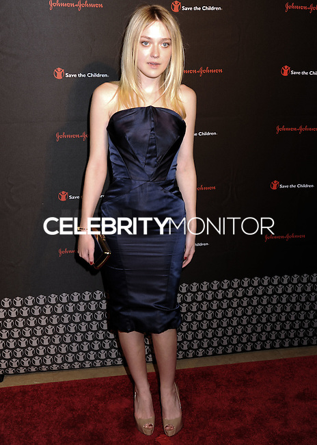 NEW YORK CITY, NY, USA - NOVEMBER 19: Dakota Fanning arrives at the 2nd Annual Save the Children Illumination Gala held at the Plaza Hotel on November 19, 2014 in New York City, New York, United States. (Photo by Celebrity Monitor)