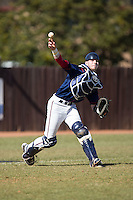 Shippensburg Raiders catcher Jake Kennedy (30) makes a throw to first base against the Belmont Abbey Crusaders at Abbey Yard on February 8, 2015 in Belmont, North Carolina.  The Raiders defeated the Crusaders 14-0.  (Brian Westerholt/Four Seam Images)