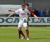 Izegem - FC Luik :..Germain Marloye (L) schermt de bal af voor Arne Scheldeman (R)..foto VDB / BART VANDENBROUCKE