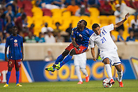 Haiti defender Jeff Louis (7) and Honduras forward Roger Rojas (21) collide. Honduras defeated Haiti 2-0 during a CONCACAF Gold Cup group B match at Red Bull Arena in Harrison, NJ, on July 8, 2013.