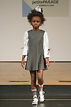 Model walks runway in an outfit by Carlucci, during the petitePARADE Children's Club fashion show at the Jacob Javits Center in New York City, on January 9, 2016.