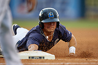 Lake County Captains right fielder Mitch Longo (39) slides into third base during the second game of a doubleheader against the West Michigan Whitecaps on August 6, 2017 at Classic Park in Eastlake, Ohio.  West Michigan defeated Lake County 9-0.  (Mike Janes/Four Seam Images)