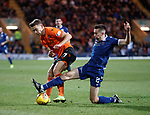08.11.2019 Dundee v Dundee Utd: Cammy Kerr cleans out Louis Appere