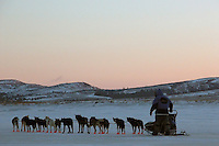 Tollef Monson gets ready to leave Unalakleet at dawn. Photo by Jon Little.