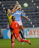 #18 Erin McLeod, goal keeper of the Washington Freedom defends a goal kick against the pressure of  #18 Frida Osterberg of the  Chicago Red Stars . The Red Stars won the game 2-1