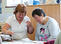 Sewing class for a learning support group, Adult Learning Centre, Guildford, Surrey.
