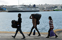 Pictured: Migrants having just arrived to Piraeus port, Greece Sunday 28 February 2016<br /> Re: Hundreds of migrants have arrived from the Greek islands to Piraeus Port, Greece