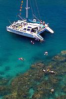 Snorkeling from a catamaran at Honokahau bay is great way to see Maui's colorful marine environment. Maui.