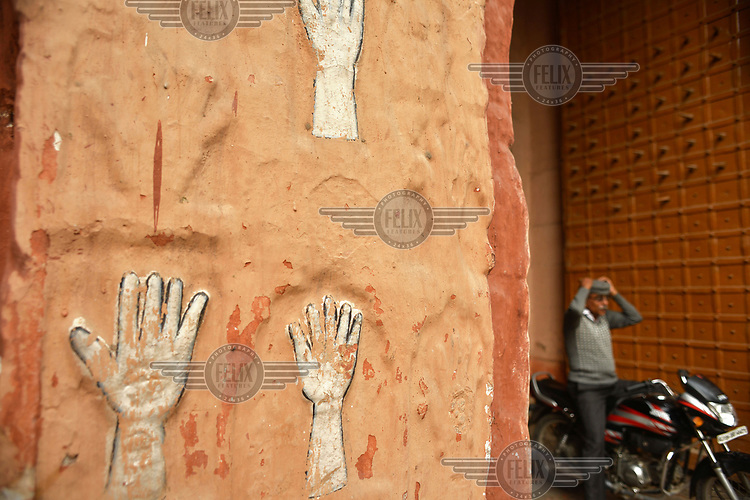 Hand prints (of women who committed sati, ritual suicide, on the death of their husband) imprinted on the walls of Sivanchi Gate.