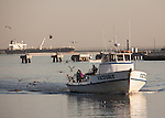 The fishing boat Victory returning to Rainbow Harbor from a sport fishing excusion in Long Beach Harbor, CA
