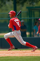 Kelly Dugan #16 of the of the GCL Phillies follows through on his swing versus the GCL Braves at Disney's Wide World of Sports Complex, July 13, 2009, in Orlando, Florida.  (Photo by Brian Westerholt / Four Seam Images)